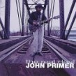 Primer John- The Real Deal (USED)